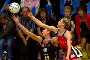 Tactix player Jane Watson (right) contests the ball with the Magic's Irene van Dyk in Tauranga last night. Photo / Alan Gibson