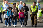 Afghan interpreters and their family's arrive at Whenuapai air base. Photo / Dean Purcell