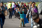 Afghan interpreters and their families arriving yesterday at Whenuapai airbase to begin new lives in New Zealand.  Photo / Dean Purcell