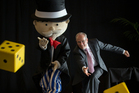 Mr Monopoly and Auckland Mayor Len Brown roll the dice in Auckland. Photo / Greg Bowker