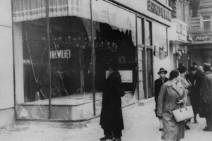 Nazis set fire to hundreds of synagogues, looted thousands of Jewish businesses and attacked Jews in Germany and Austria. Photo / AP