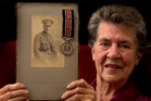 Nolene Wight holds a photo of her father, Herbert Flowerday, and the Military Medal he received for bravery in 1918. Photo / Brett Phibbs