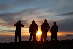 Scott Base staff watch the sunset as Antarctica heads towards permanent darkness through the winter months. Photo / Becky Goodsell