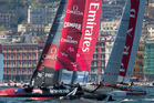 Emirates Team New Zealand, left, competes with Luna Rossa Swordfish in the fleet racing portion of the America's Cup World Series, in the bay of Naples. Photo / AP