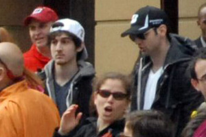 This image of Tamerlan Tsarnaev (black cap) and his brother was taken at the Boston marathon, about 10 to 20 minutes before the bombs exploded. Photo / AP