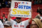 A fan holds a 'Boston Strong' sign before a baseball game between the Boston Red Sox and the Kansas City Royals in Boston. Photo / AP