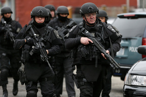 Police in tactical gear took part in the search for the bombers. Photo / AP