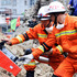 Rescuers use a life detector to search for survivors in the quake-hit town of Muping, Baoxing County in southwest China's Sichuan Province. Photo / AP