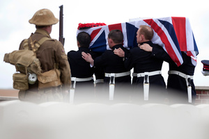 The four soldiers, whose bodies were found four years ago in a field, were given full military honours.  Photo / AP