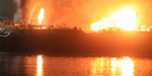 Barges burn after massive explosions