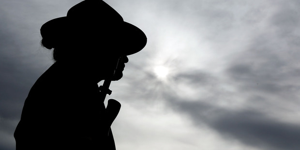 A soldier stands guard during the National Commemorative Service at the National War Memorial. Photo / Getty Images