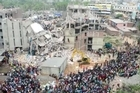 Bangladeshi police battle to control huge crowds of garment workers angrily protesting the death of more than 300 colleagues in a collapsed building as rescue efforts stretch into a third day.