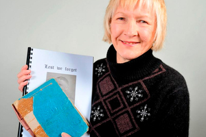 Margaret Pollock with the original version and a digital version of her late father's diary of life in European prisoner of war camps during World War 2. Photo / Otago Daily Times
