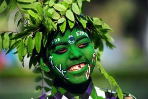 An Indian youth dressed as a tree during an awareness event commemorating Earth Day in Allahabad. Photo / AFP