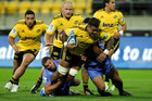 Faifili Levave of the Hurricanes is tackled during round 10 of the Super Rugby season. Photo / Getty Images