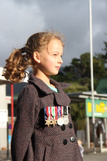 Lily Merrett, 8, Featherston, wears her great-grandfather's WW2 medals at Featherston's Anzac Service.