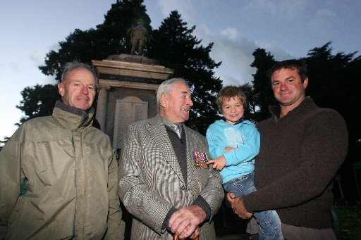 Anzac Day Dawn Ceremony of Remberance at the Cenotaph at Queen Elizabeth Park, Masterton.  Four genarations grandfather Christopher Bunny, great grandfather John Bunny, piolt RNZAF, great grandson Hamish Bunny, 4, and his dad Andy Bunny.
