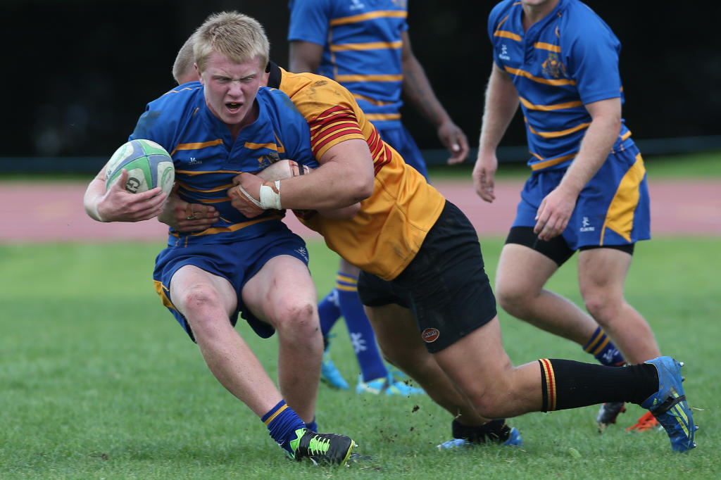 Joel Little of Tauranga Sports Colts is tackled during a match vs Te Puke Sports Colts, Tauranga Domain.