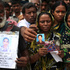 A man holds out a picture of his missing relative in Savar, near Dhaka, Bangladesh. Photo / AP