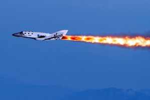 Virgin Galactic's SpaceShipTwo was dropped from its 'mothership' over Mojave, California in its first powered flight, a test that moves Virgin Galactic toward its goal of flying into space. Photo / AP