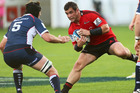 Corey Flynn of the Crusaders with the ball, Cadeyrn Neville of the Rebels in defence during the round 11 Super Rugby match between the Crusaders and the Rebels. Photo / Getty Images.