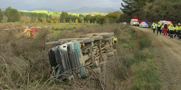 The driver of this truck was injured when it rolled in Motueka. Photo / Nelson Marlborough Rescue Helicopter.