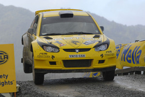 Last year's winner Chris tkins in action at the 2012 International Rally of Whangarei in a Proton. Photo / Euan Cameron