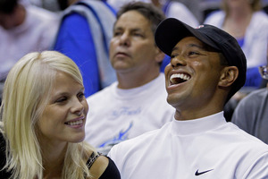 Tiger Woods with Elin Nordegren in 2009, before his infidelity scandal hit the headlines. Photo / AP