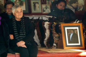 Maori Party co-leader Tariana Turia sits next to the coffin. Photo / Alan Gibson
