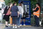 Travellers top up their Hop cards at Middlemore Station yesterday. Photo / Greg Bowker