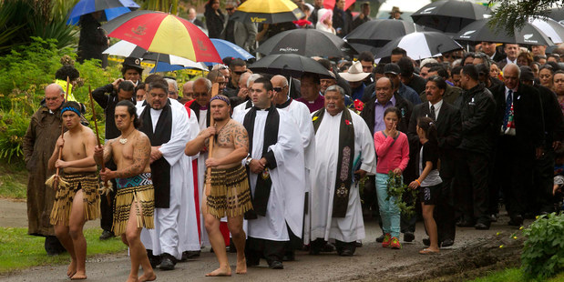 Warriors and pastors lead the mourners to the urupa for the burial. Photo / Alan Gibson