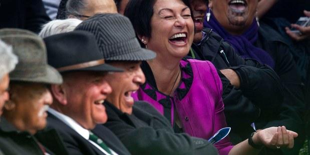 Hekia Parata enjoys a joke at Parekura Horomia's funeral. Photo / Alan Gibson