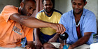 Tony (far right) accepts a bowl of traditional Fijian kava. Photo / Derek Cheng