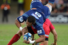 Peter Saili of the Blues gets up-ended last weekend against the Reds. Photo / Getty Images