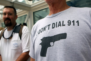 NRA attendee, John Joseph of Sebastian, Fla., waits in line outside the George R. Brown Convention Center before the opening of the National Rifle Association's 142 Annual Meeting. Photo / AP