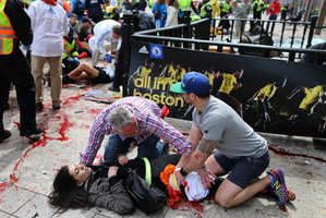 Separating truth from rumour and deciding what to publish after the Boston Marathon bombings was a test not all news media passed with honours. Photo / Boston Globe