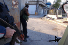 Syrian rebels taking cover in the Barzeh district of Damascus, Syria. Photo / AP