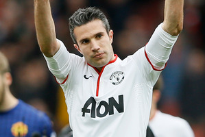 Robin van Persie waves to fans at the Emirates yesterday. Photo / AP