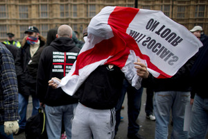 English Defence League members during a protest at the Houses of Parliament in London.  Photo / AP