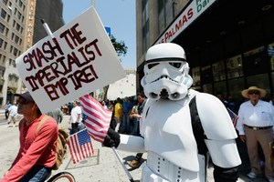 A demonstrator wearing a Star Wars storm trooper uniform participates with thousands of people in May Day march and rally in Los Angeles, Photo / AP