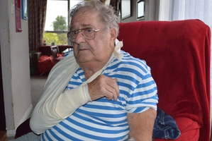 Jimmy Hambley convalesces at home in Runanga after his arm was bitten to the bone in a dog attack yesterday. Photo / Viv Logie