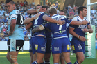 Bulldogs players celebrate a try during the round seven NRL match between the Sharks and the Bulldogs. Photo /Getty Images