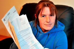 Milton process worker Danelle Byrne holds several IRD letters demanding she file an overdue GST return. Photo / Linda Robertson