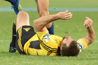 Conrad Smith lies prone after making a poor tackle. Photo / Getty Images