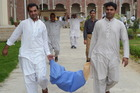 Pakistani election presiding carry election materials in Rawalpindi. Photo / Getty Images