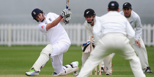 England batsman Joe Root hits out during day two of the tour match between England Lions and New Zealand. Photo / Getty Images