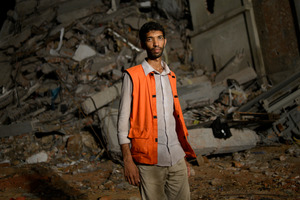 Volunteer Saiful Islam Nasar poses in front of the rubble of a building collapse in Savar, near Dhaka, Bangladesh. Photo / AP