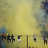 Boca Juniors fans cheer for their team on top of a fence during an Argentina's league soccer match against River Plate in Buenos Aires, Argentina. Photo / AP