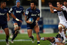 Rene Ranger of the Blues runs rampant over James O'Connor of the Rebels during the round 13 Super Rugby match between the Blues and the Western Force. Photo / Getty Images.