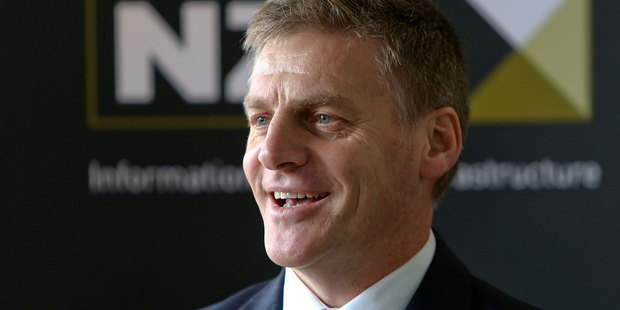 Loading Finance Minister BIll English at the NZX offices celebrating the sharemarket listing of Mighty River Power.  New shareholders paid $2.50 each for shares in the state-owned power company. They began trading at  $2.73 each. Photo / Gettys